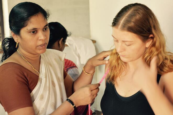 Hannah gets measured by Beena for our first collection in Wayanad