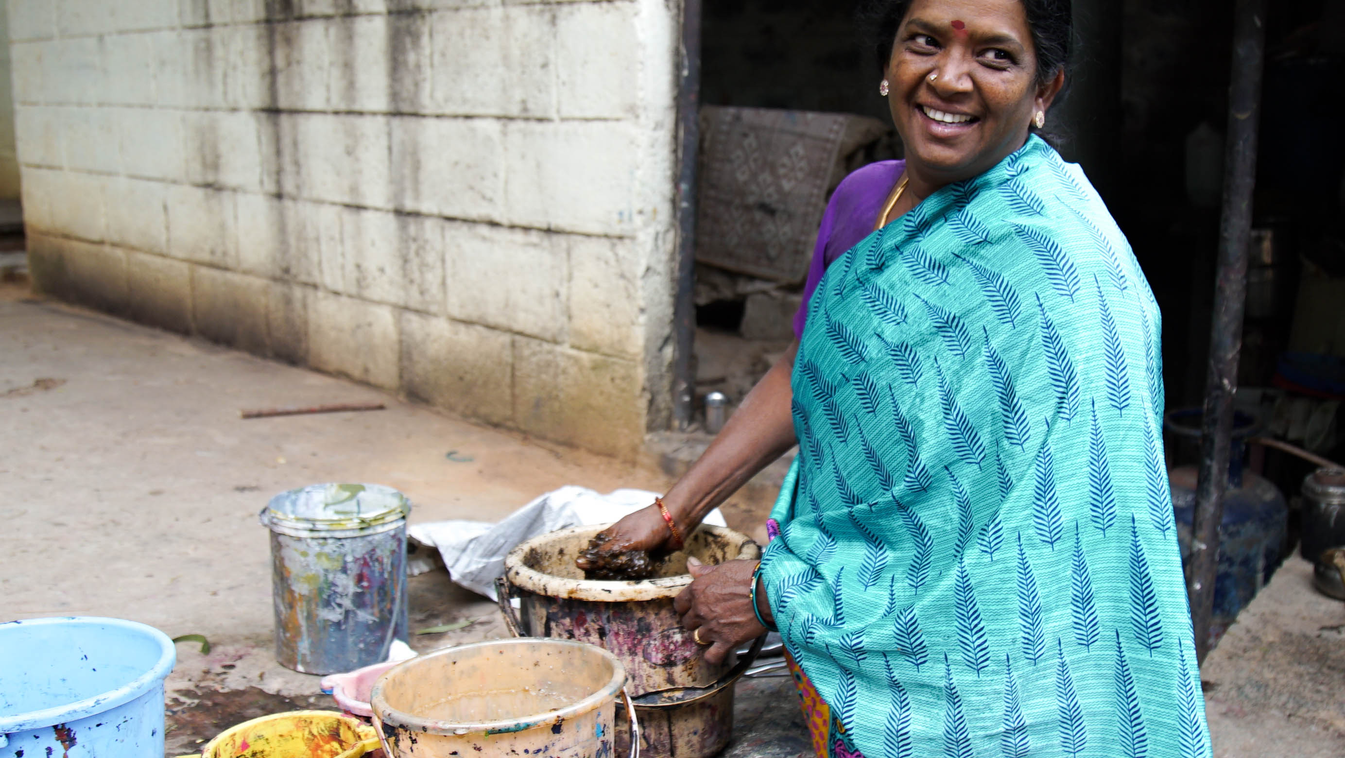 Tharangini mixing dyes for fabric
